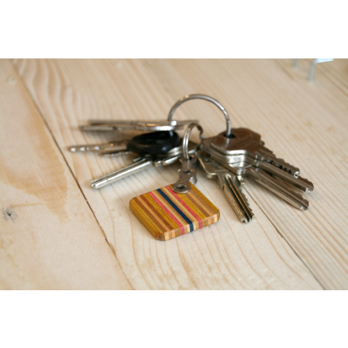 Yellow-pink key chain made of skateboard deck