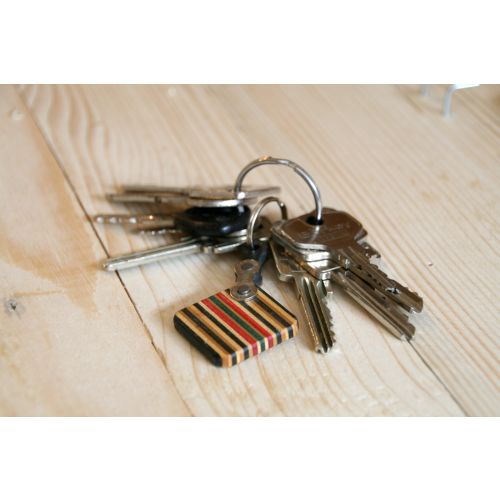 Recycled wooden key chain of skateboards