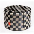 Circle-shaped ottoman in recycled security seatbelt