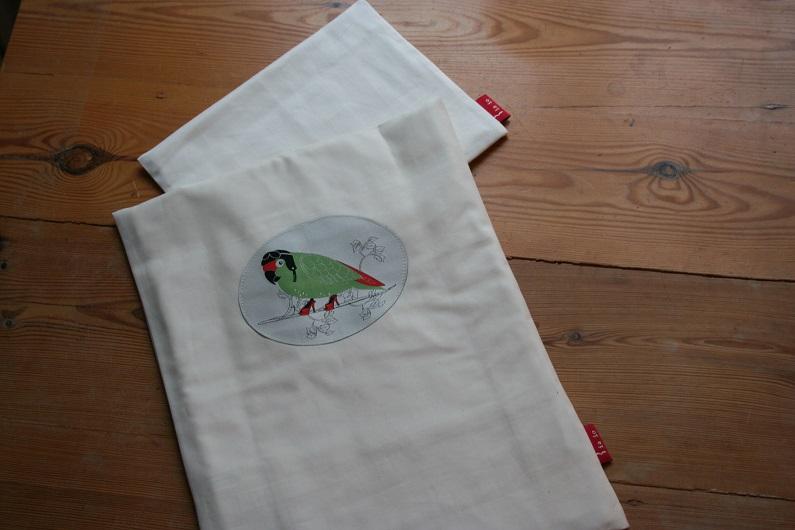Puppenbettwäsche aus Bio-Baumwolle mit Papagei, 4-teilig
